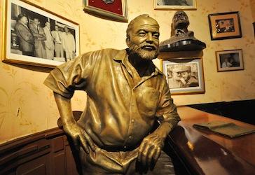Hemingway's full size bronze statue on his favorite bar stool in El Floridita