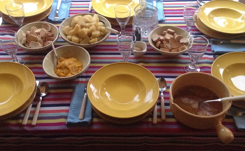 Bouillabaisse family table with croutons, saffron potatoes croutons again, fish soup and rouille