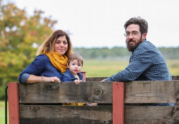 amber+husband+baby on wagon.jpg