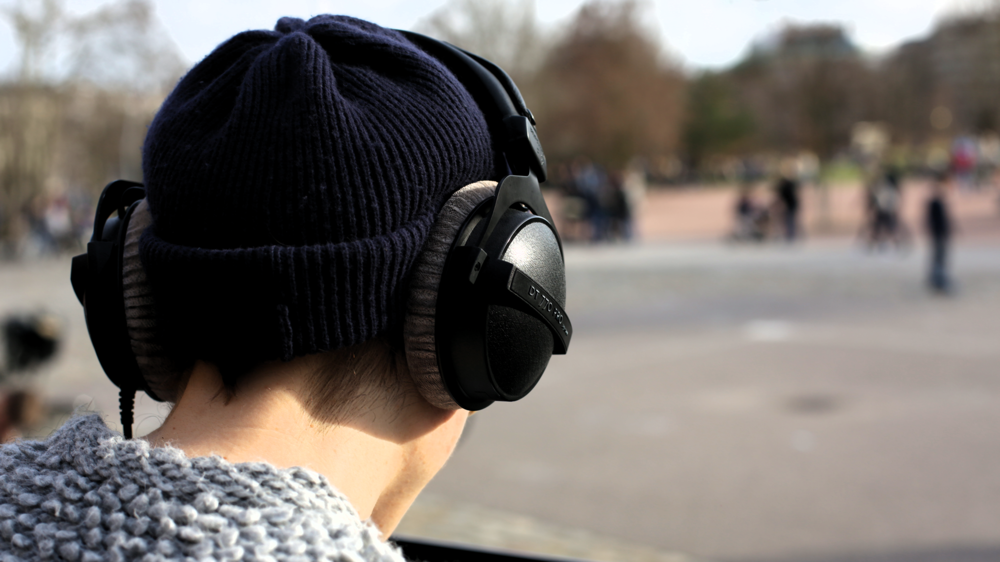 IP4B1028-with-headphones-in-the-park.png