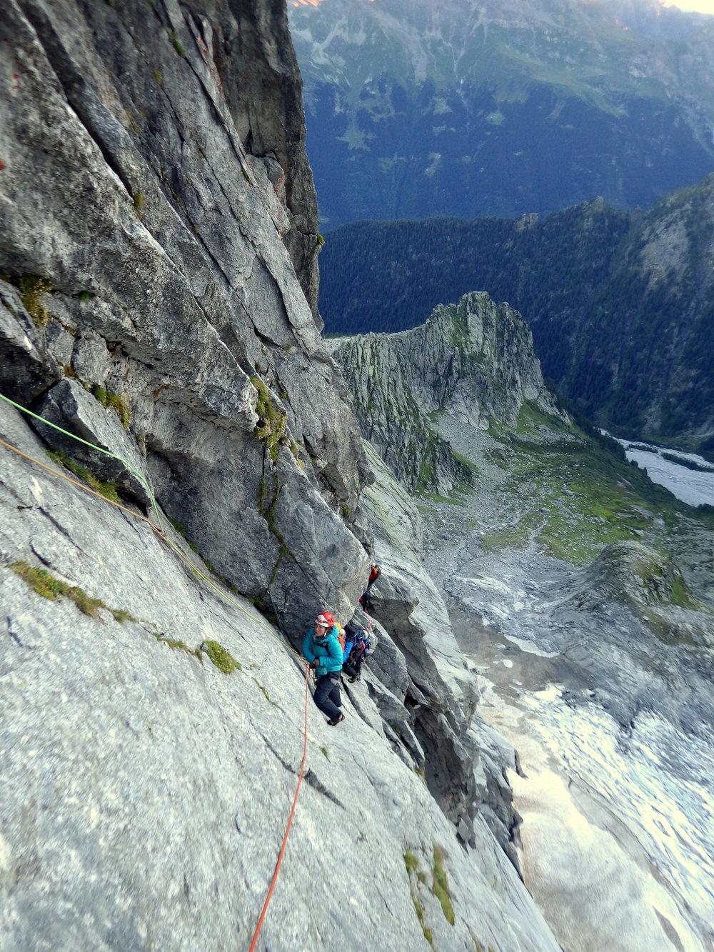 Mandy eyeing up the traverse, Cassin Route, Piz Badile