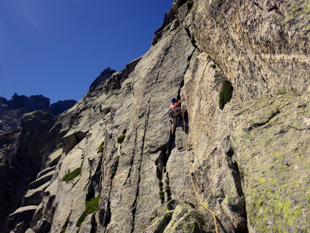 Mandy cruising up the second pitch of the Traverse of La Vergine