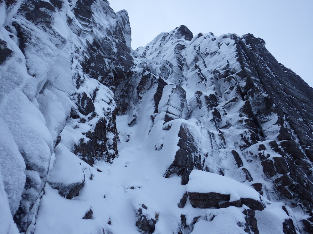 The very lean crux pitch of Ewen Buttress- there is some useful ice to help you over the upper step