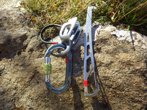Belay Plate, Oval Screwgate Carabiner, and a Nut Key