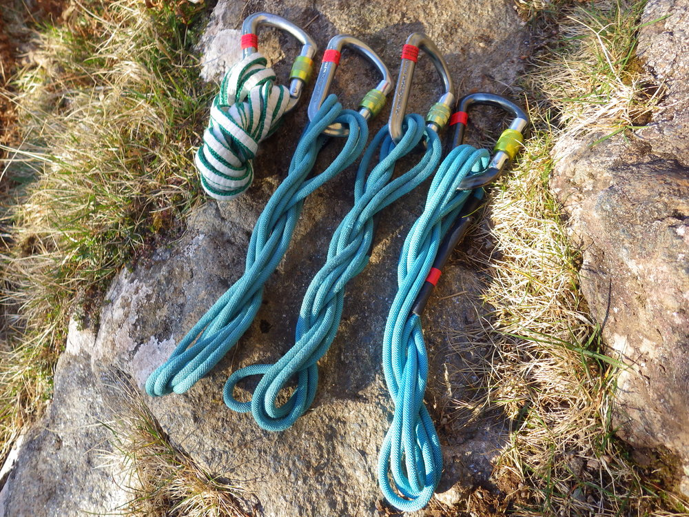 Three 120cm Aramid slings, and one 240cm dynema sling, each with a screwgate carabiner