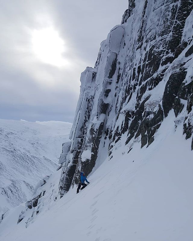 Mandy eyeing up the lines on Arch Wall today.  We climbed 'Fingers and Thumbs' which is an apt name as its steeper and more awkward than it looks.  #scotwinter #cairngorms @ami_professionals