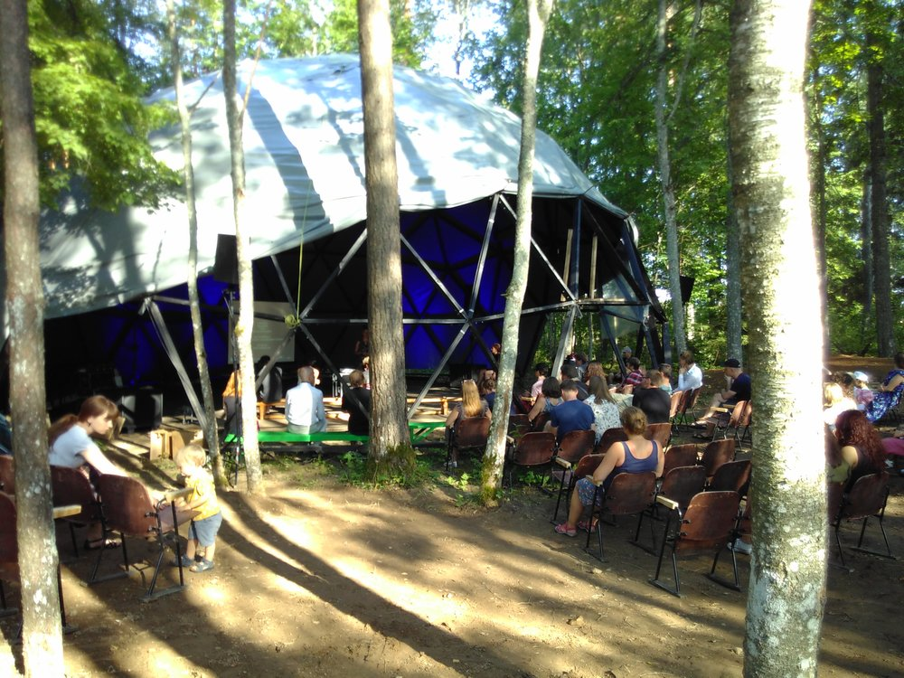 Audience listening to a concert at the second dome stage.