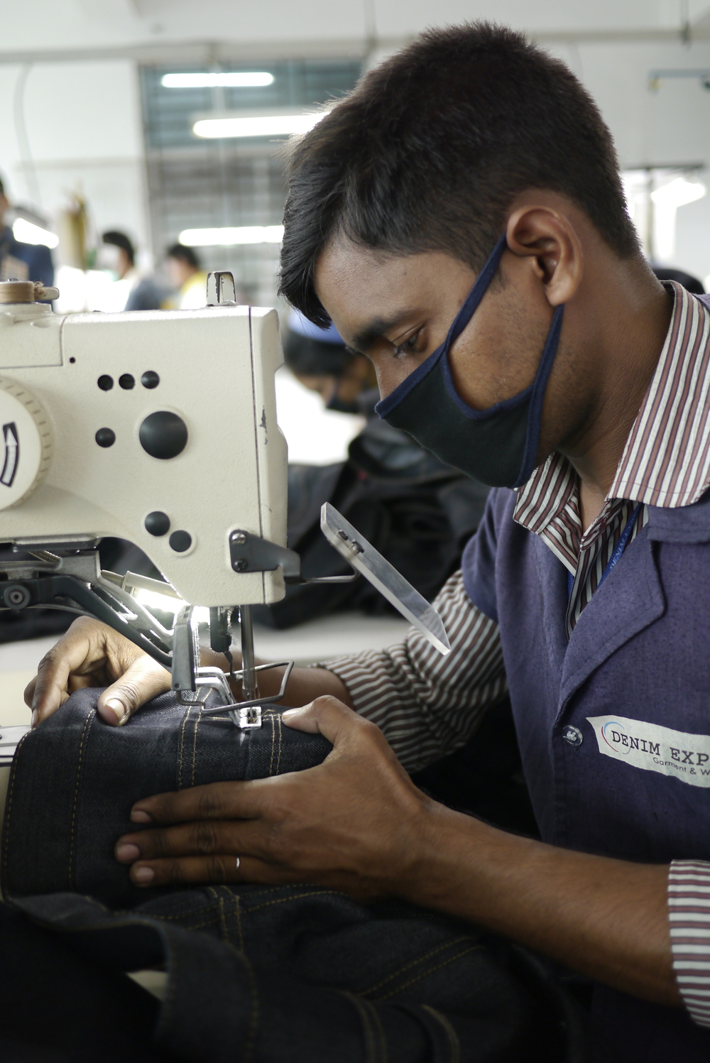 A worker at Denim Expert Limited, Photo by Sadia Rafique