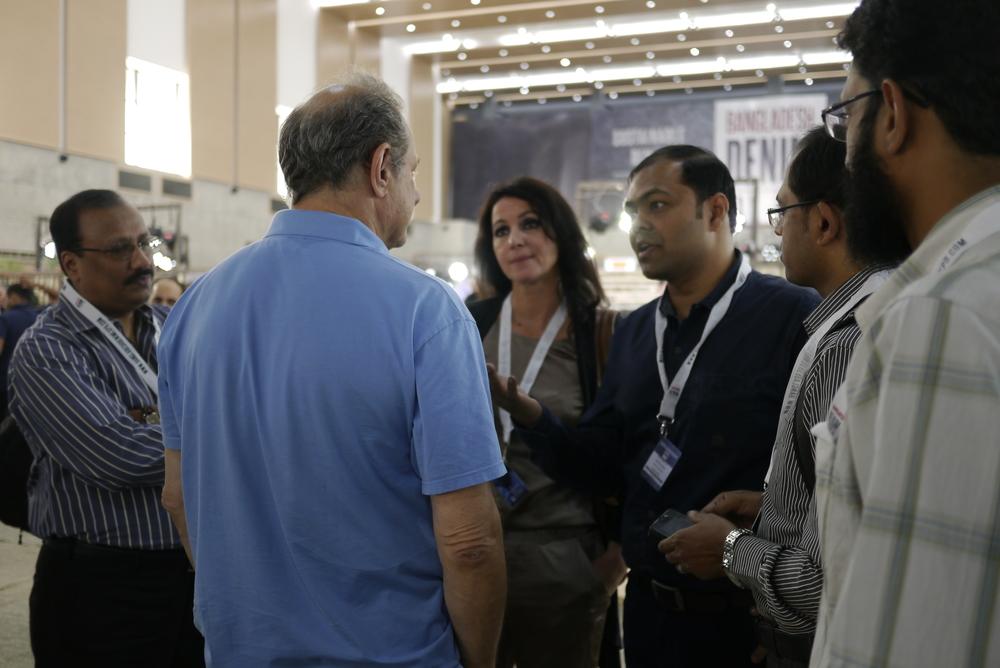 Andrew Olah and Mustafiz Uddin talking at the expo, photo by Sadia Rafique