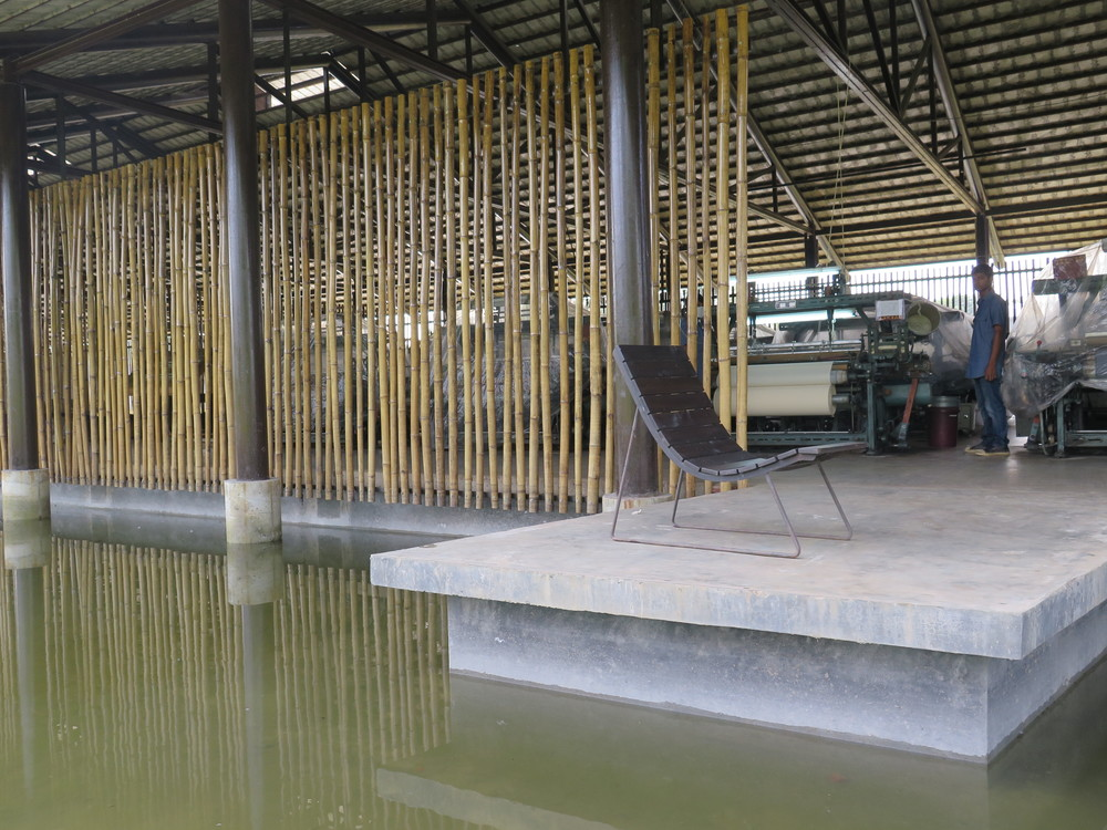 Photo of the Shuttle loom bamboo room at Partex. Photo badly taken by me.