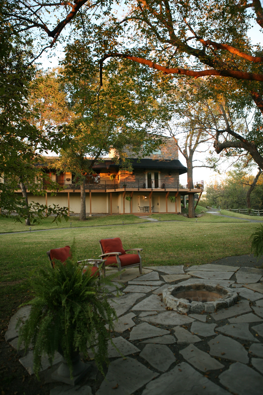 View of firepit and grounds behind Two Hearts