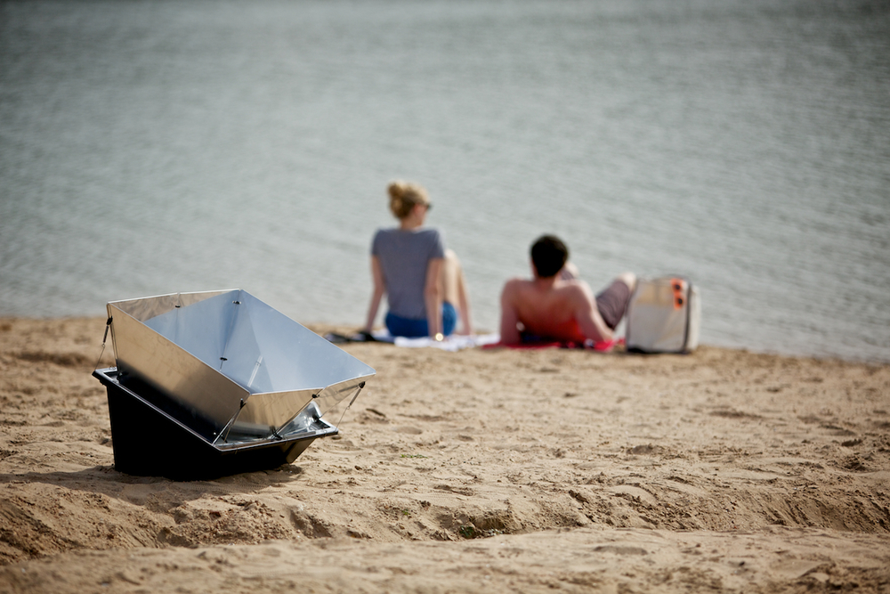 No one gets stuck in the kitchen when you cook outside with the Solavore Sport solar oven.