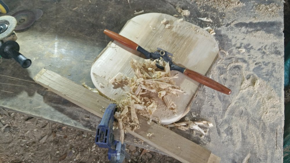 Next step is smoothing, using a beltsander, grinder and drill sanding attachment, or as shown here a spokeshave as the handtool option