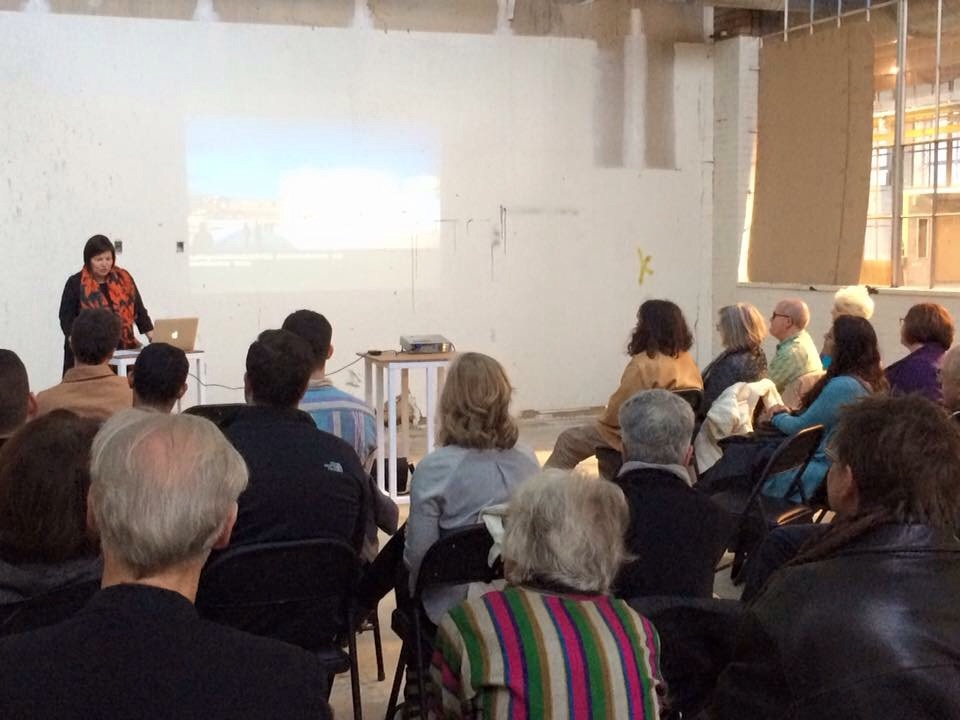 Mary Jane Jacobs  giving an artist talk at Radiant Hall.