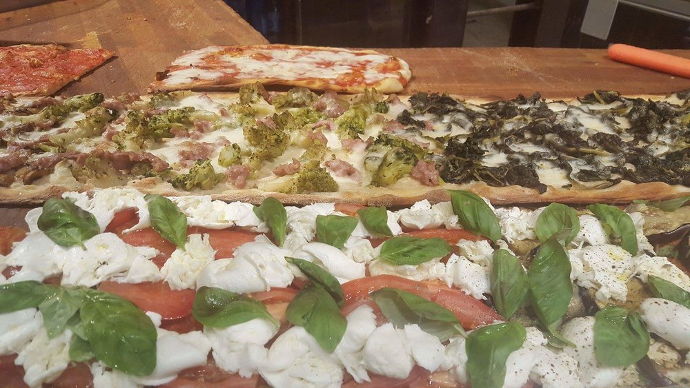 At Roscioli Antico Forno, tell the guy behind the counter how wide a slice you'd like.  How hungry are you??