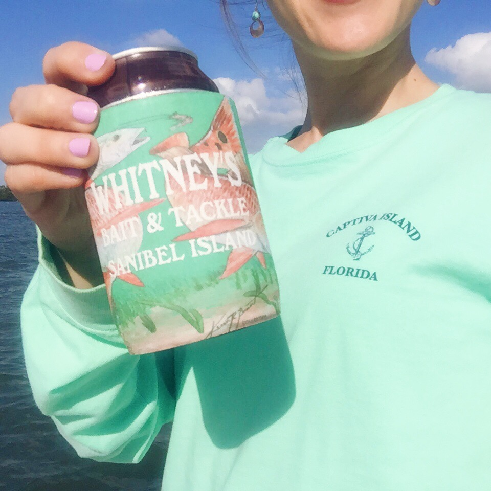 A sunny Sunday afternoon, spending time watching tons of boats go by as Bobby fishes. Me, repping my Captiva Island shirt in mint and holding the Whitney's Bait and Tackle coozie with Cigar City Brown Ale.