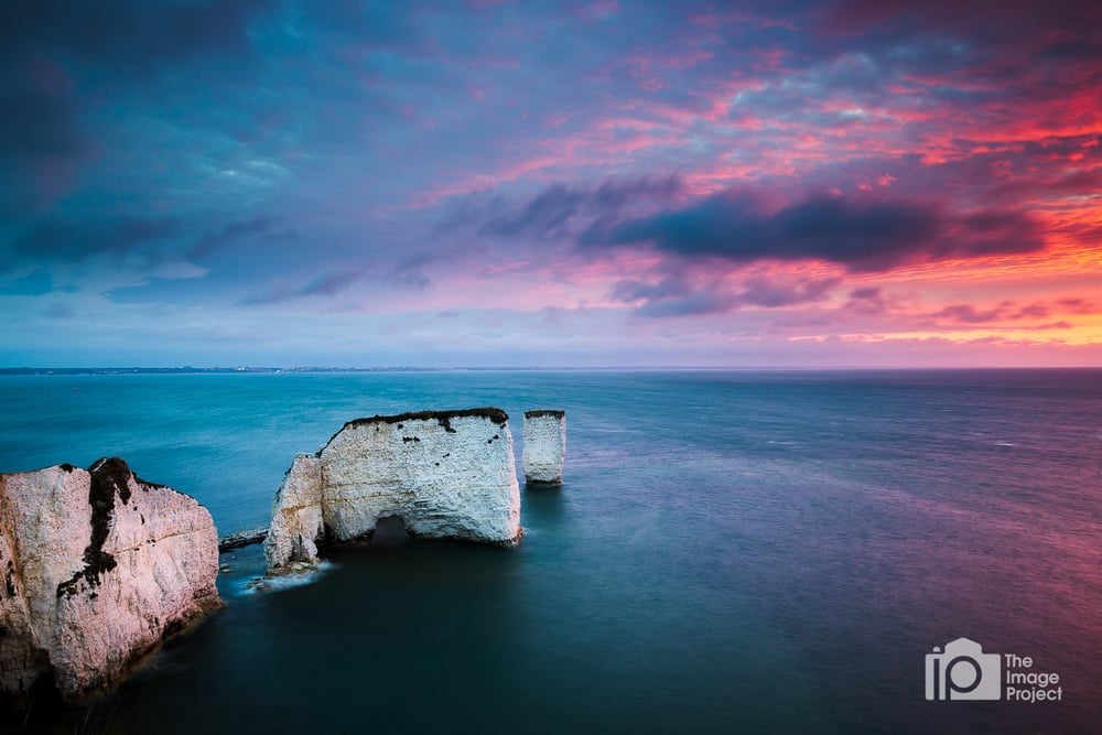 Vivid sunrise over Old Harry, Studland