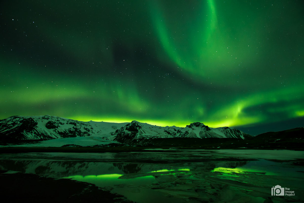 northern lights over ice lake in southern iceland taken 2015