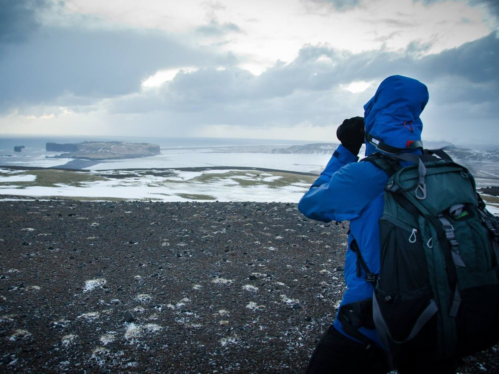 Trying to stand upright in a gale in Iceland! Photo courtesy of Callum @Tinged Memories