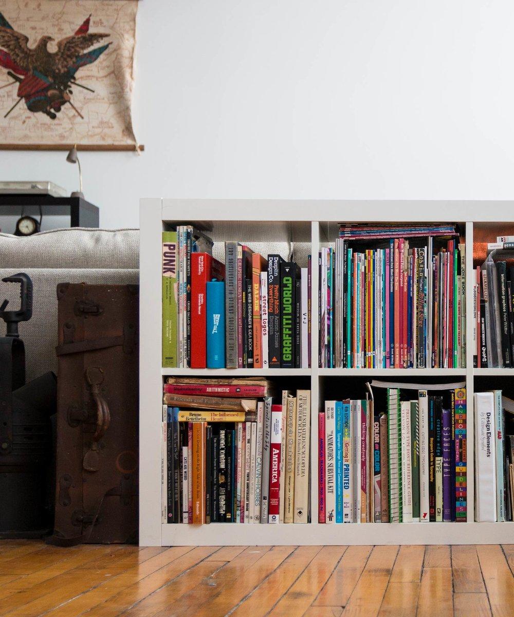 Graphic design studio with design books for inspiration
