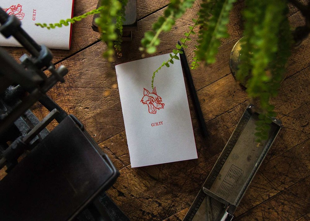 Letterpress printing with sketchbook and plant