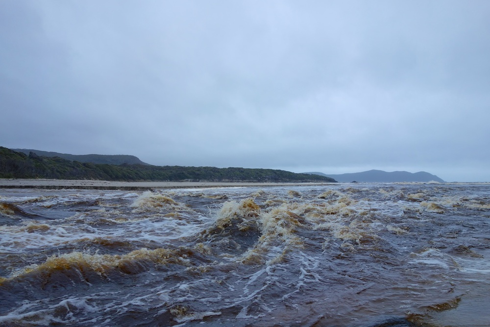 Day 6 was meant to be Granite Beach to Lion Rock, but because of this flooded river, we got stuck at South Cape Rivulet for the night