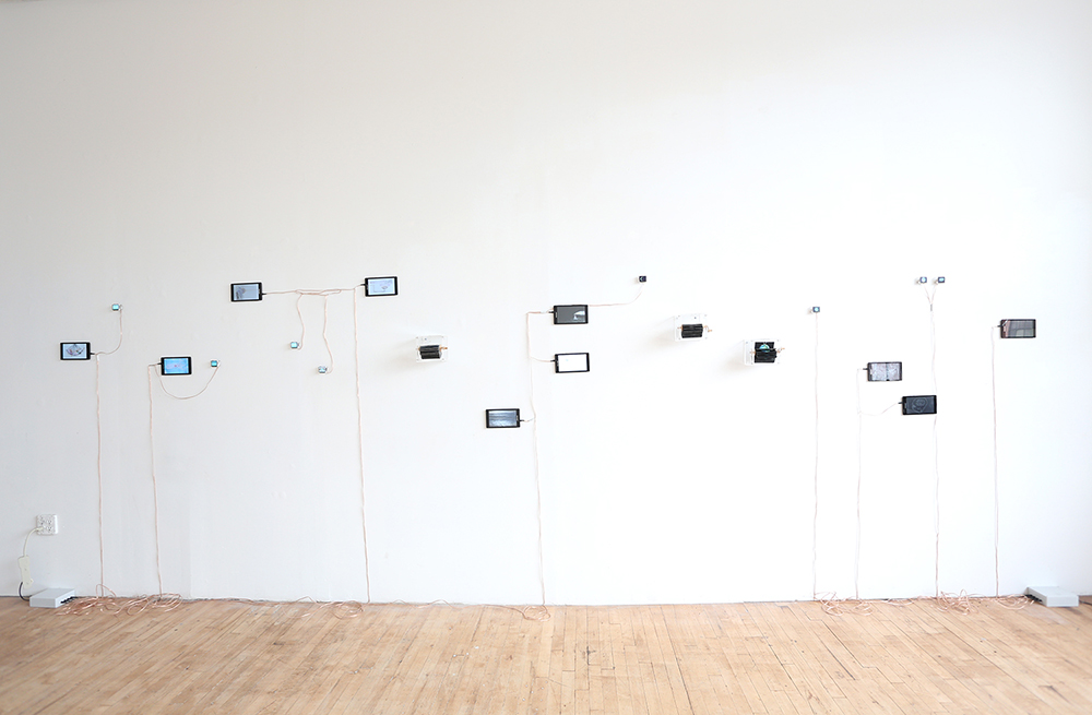 """Short Loops, 2015, multi channel installation of 18 stop motion animations, 10 7"""" tablets, 8 custom display modules and 3 flipbooks, dimensions variable. Installation view, CHASM Gallery, New York, 2015."""