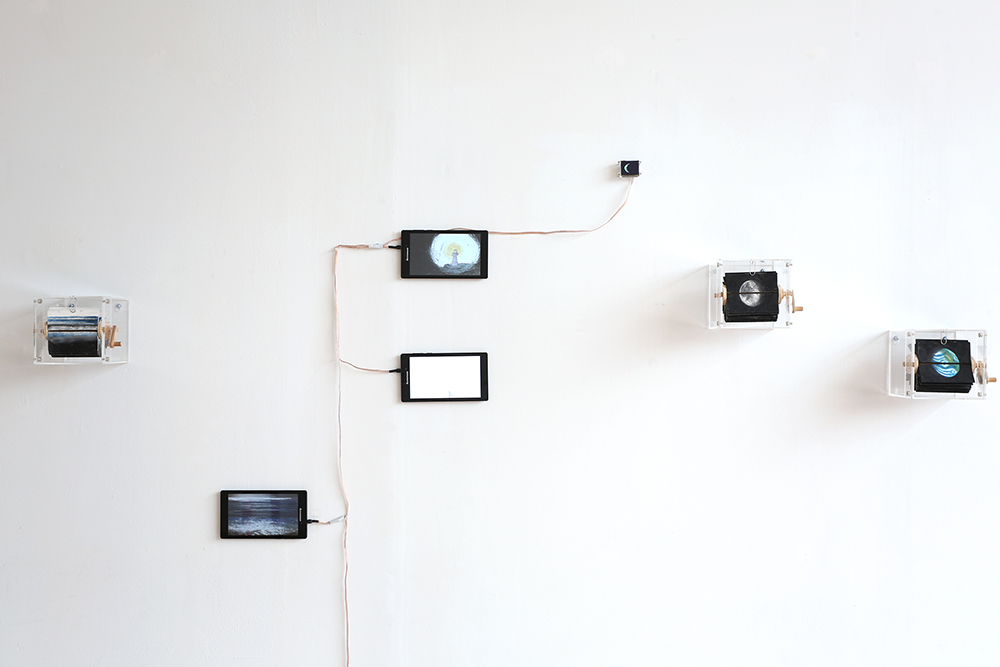 """Short Loops  (detail), 2015, hand-drawn animation on 10 7"""" tablets, 8 custom display modules, 3 flip books, dimensions variable Installation view, CHASM Gallery, New York"""