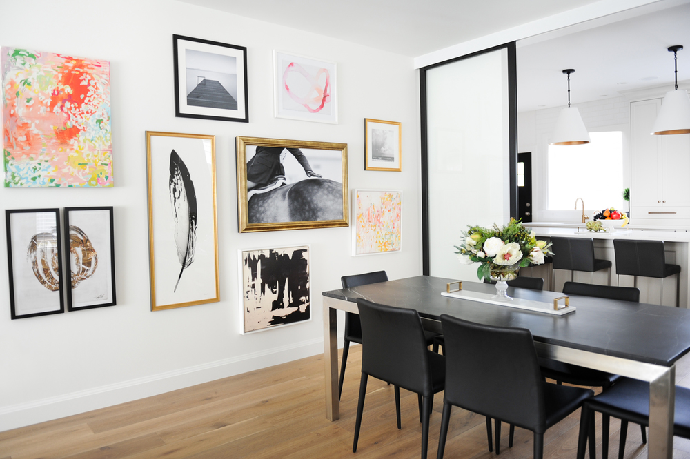 Interior Design By Chrissy Cottrell: principal designer at Curated Home By Chrissy & Co in Vancouver BC  Stunning black marble dining table with charcoal leather chairs. The gallery wall really adds so much charm to the space.