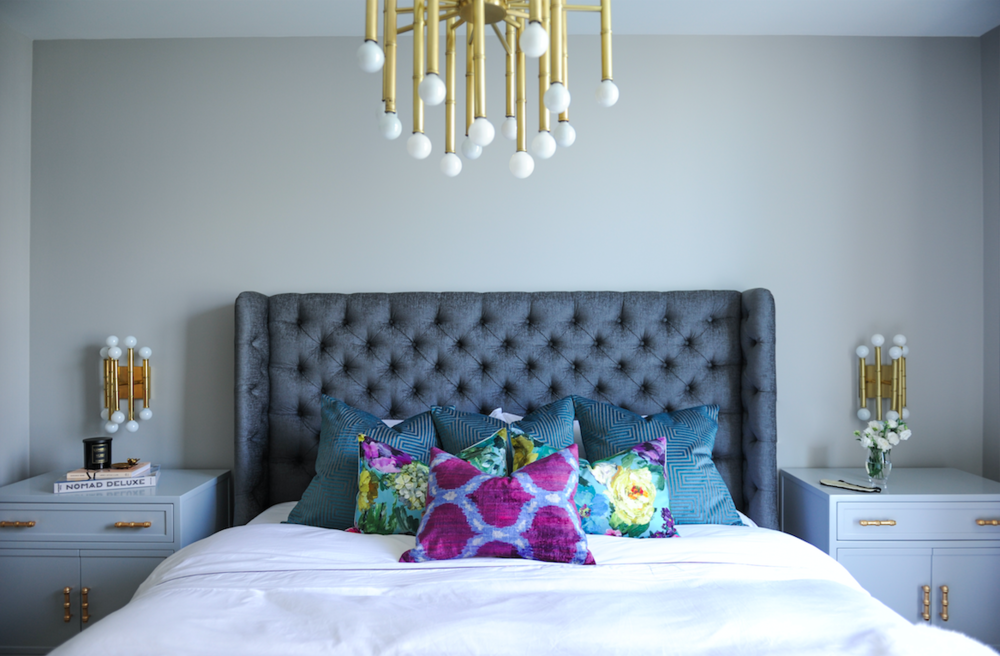 Interior Design By Chrissy Cottrell: principal designer at Curated Home By Chrissy & Co.  Chic bedroom design featuring tufted velvet headboard, brushed brass lighting and playful toss pillows.