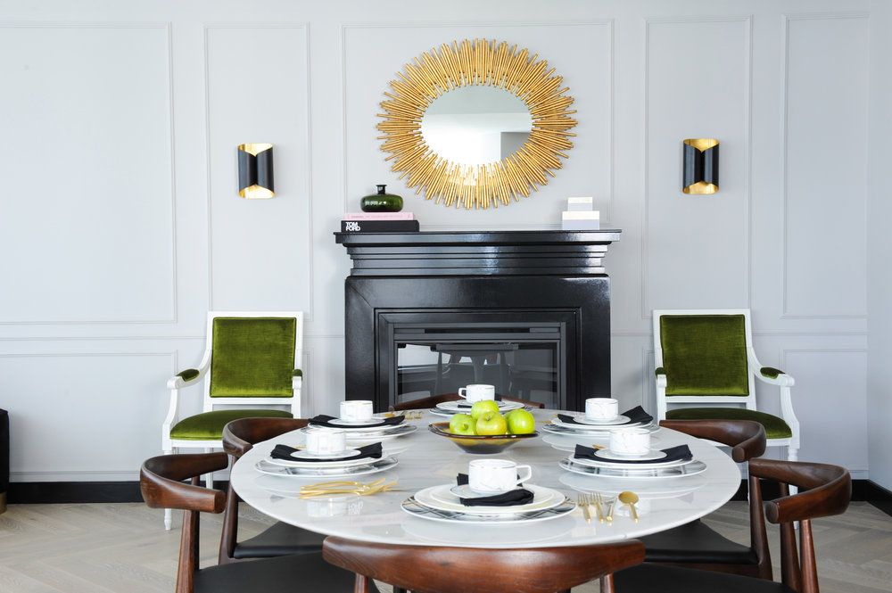 Interior Design By Chrissy Cottrell: principal designer at Curated Home By Chrissy & Co.  Stunning tulip marble dining table, gold mirror and green accents.