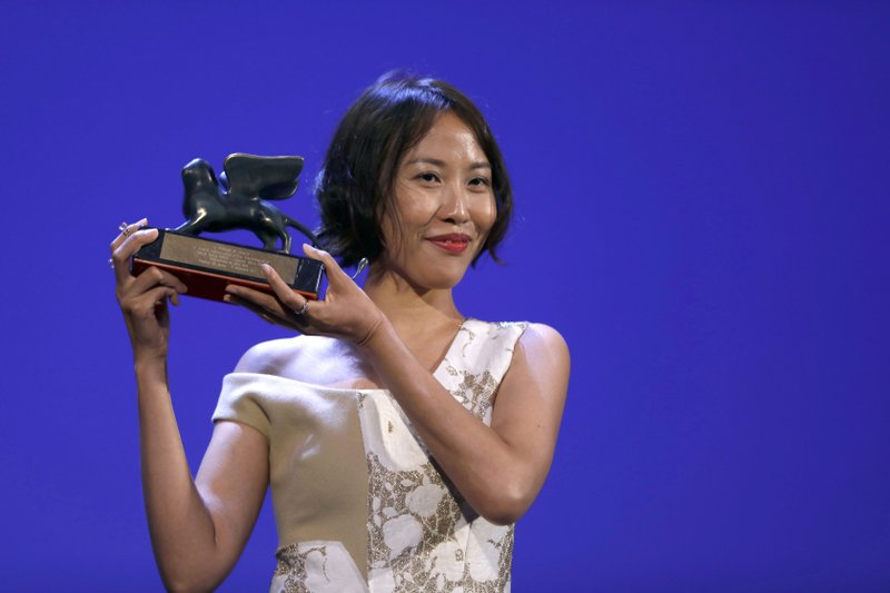 "Gina Kim holds the Venice Virtual Reality Prize for best VR story during the award ceremony at the 74th Venice Film Festival at the Venice Lido, Italy. Through a partnership of storytelling and technology, Kim finally brought the 1992 murder to life in ""Bloodless,"" a 12-minute piece that won the award for best VR story at this year's Venice Film Festival."