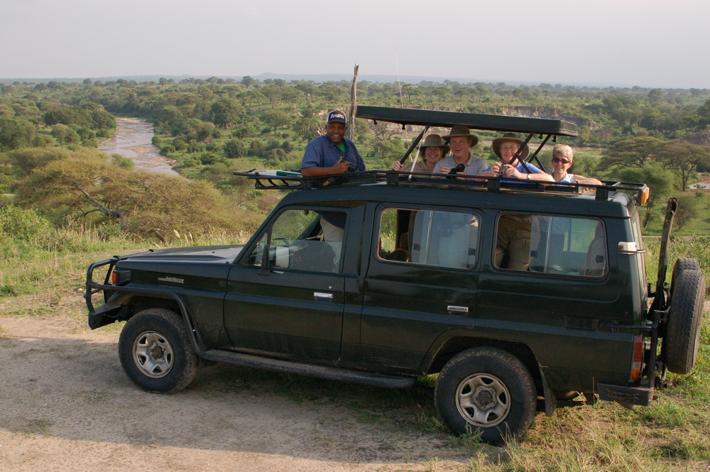 Green Land Rover and group.JPG