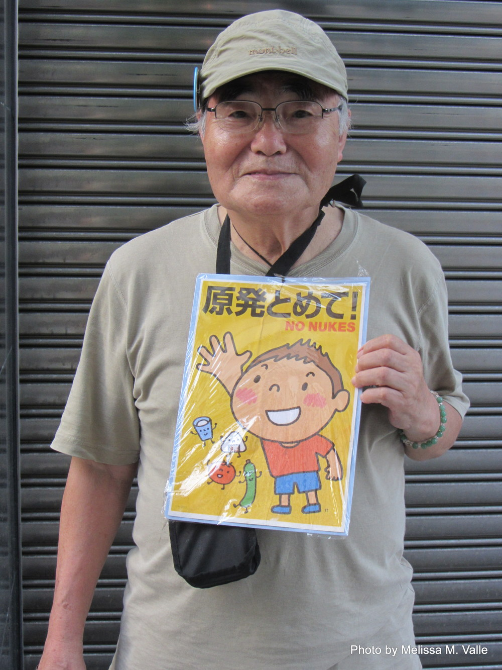 Anti-nukes protester. He and his sign are oddly super adorable given the circumstances.