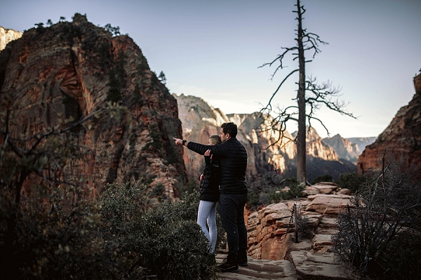 Couple at Scouts Landing in Zion National Park Utah for their red rock engagements