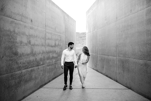 Couple walking in beautiful architecture in the desert