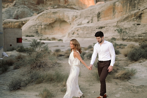 Couple walking through Arizona desert