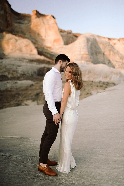 Couple standing and laughing in Utah desert