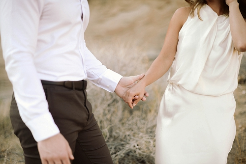Engaged couple holds hands in Southern Utah desert