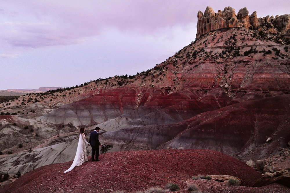 """Shelley, about her wedding in Boulder/Escalante, Utah:   """"Haley really captured the vision of our dream wedding. My husband is a wonderful landscape photographer, and I love fashion. She managed to merge both of our styles together to capture amazing images. When selecting a wedding photographer its important to remember that your photos are all that you really get to take with you from your wedding. We trusted Haley to capture our wedding and she delivered above and beyond our expectations. She takes the time before your day to plan some shots, get locations and discusses your dream wedding photography. She gets a list of family members and loved ones so that she knows ahead of time which people you are hoping to get pictures with. She is extremely flexible and easy going while on shoot but delivers incredible images. Just book her already!"""""""