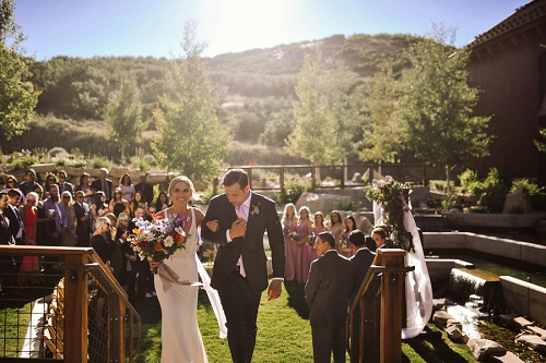 Bride and groom exiting their wedding ceremony in Park City