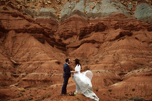 couple reading vows during their elopement at capitol reef national park