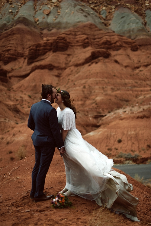 Couple kisses during their capitol reef vow exchange