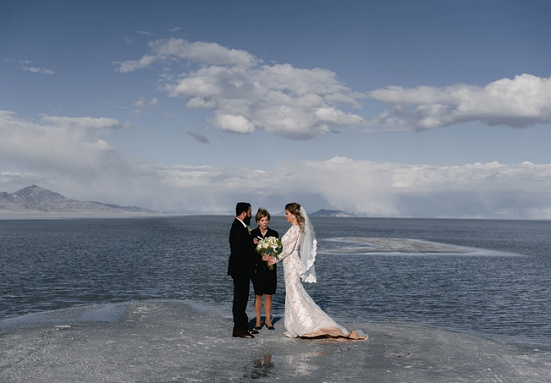 Couple holds hands at their elopement at the Salt Flats