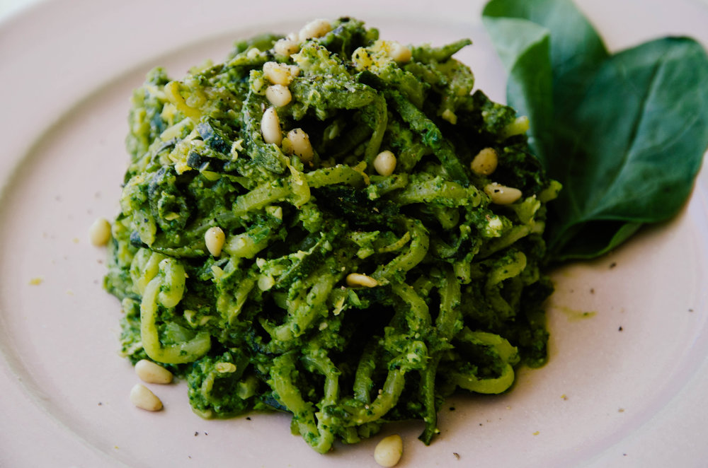 Zucchini Noodles with Spinach, Garlic Scape Pesto topped with Pine Nuts and Lemon Zest