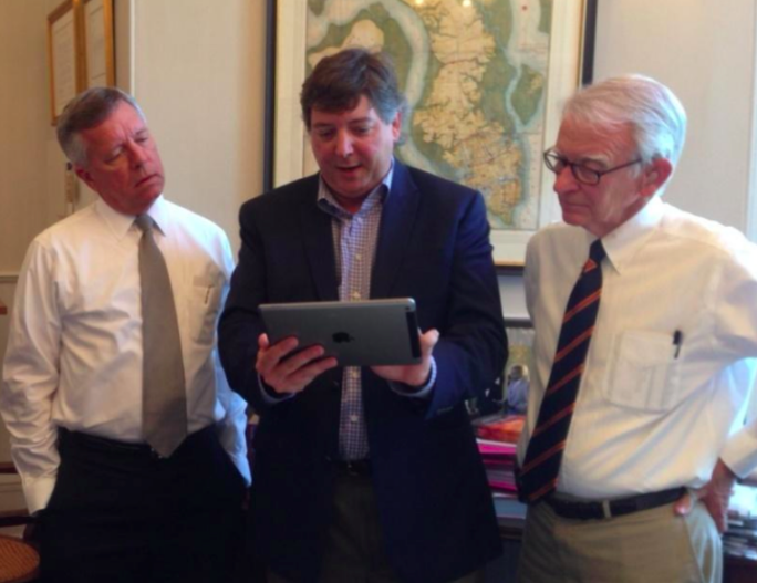 Rob Honeycutt shows off his new product to Joseph P. Riley, right, the mayor of Charleston, SC.