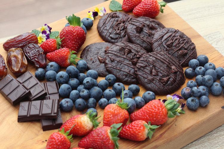 Sweet dessert platter: fresh berries, double chocolate black bean cookies and dark chocolate
