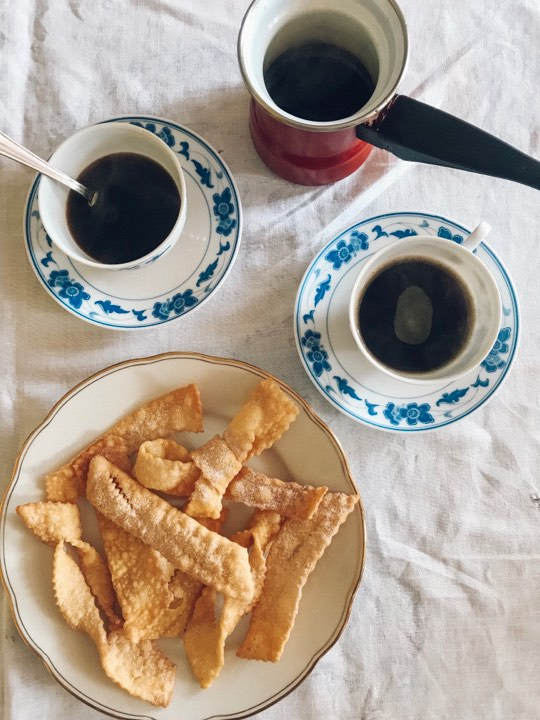 Morning tea: kroštule served with black coffee