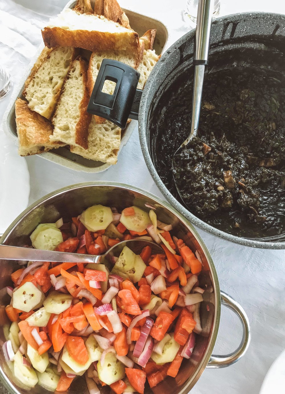 Crni rižot - black cuttlefish risotto. A popular dish in the Dalmatia region, which gets its trademark black colour from the addition of squid link. Served with a salad, and fresh bread to wipe your plate clean with!