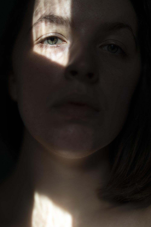 self portrait in window light
